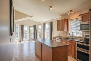 Photo 9: 102 Morris Place: Didsbury Detached for sale : MLS®# A1045288