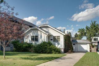 Main Photo: 210 21 Avenue NE in Calgary: Tuxedo Park Detached for sale : MLS®# A1146874