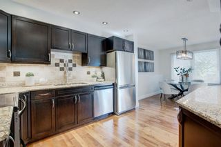 Photo 8: 212 Coachway Lane SW in Calgary: Coach Hill Row/Townhouse for sale : MLS®# A1153091