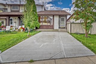 Photo 2: 167 Templevale Road NE in Calgary: Temple Semi Detached for sale : MLS®# A1140728