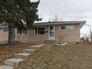 Main Photo: 1402 Rosehill Drive NW in Calgary: Rosemont Duplex for sale : MLS®# A1095463