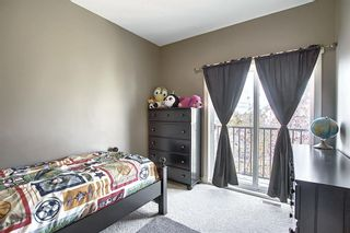 Photo 25: 47 WEST SPRINGS Lane SW in Calgary: West Springs Row/Townhouse for sale : MLS®# A1039919