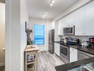 Photo 11: 402 11 Evanscrest Mews NW in Calgary: Evanston Row/Townhouse for sale : MLS®# A1070182