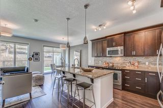 Photo 4: 215 Sunset Point: Cochrane Row/Townhouse for sale : MLS®# A1148057