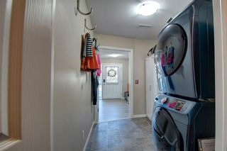 Photo 24: 149 WINDSTONE Avenue SW: Airdrie Row/Townhouse for sale : MLS®# A1033066