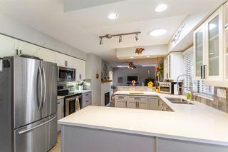 "Photo 9: 5914 135A Street in Surrey: Panorama Ridge House for sale in ""PANORAMA RIDGE"" : MLS®# R2599845"