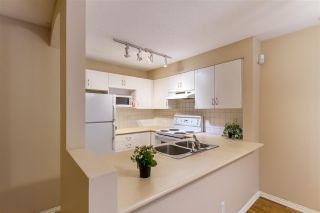 "Photo 7: 303 3099 TERRAVISTA Place in Port Moody: Port Moody Centre Condo for sale in ""GLENMORE"" : MLS®# R2401739"