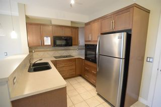 Photo 1: 204 26 VAL GARDENA View SW in Calgary: Springbank Hill Apartment for sale : MLS®# A1045498