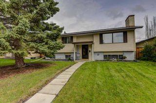 Photo 1: 128 Cedarpark Green SW in Calgary: Cedarbrae Detached for sale : MLS®# A1109711