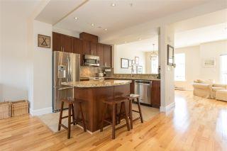 "Photo 2: 7 40632 GOVERNMENT Road in Squamish: Garibaldi Estates Townhouse for sale in ""Riverswalk"" : MLS®# R2160487"