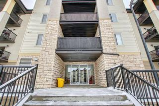 Photo 4: 7402 304 MacKenzie Way SW: Airdrie Apartment for sale : MLS®# A1081028