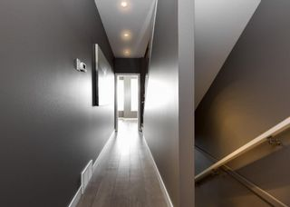 Photo 16: 2001 1 Avenue NW in Calgary: West Hillhurst Row/Townhouse for sale : MLS®# A1077453