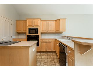 """Photo 9: 18 4001 OLD CLAYBURN Road in Abbotsford: Abbotsford East Townhouse for sale in """"Cedar Springs"""" : MLS®# R2469026"""