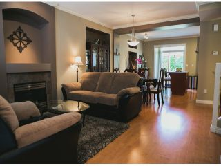 """Photo 1: 4 15168 66A Avenue in Surrey: East Newton Townhouse for sale in """"Porter's Cove"""" : MLS®# F1317928"""