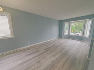 Photo 11: 23 Erin Meadows Court SE in Calgary: Erin Woods Detached for sale : MLS®# A1124454