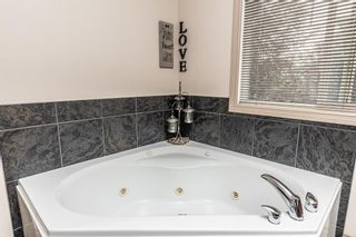 Photo 27: 78 CRYSTAL SHORES Place: Okotoks Detached for sale : MLS®# A1009976
