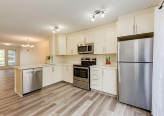Photo 11: 402 2445 Kingsland Road SE: Airdrie Row/Townhouse for sale : MLS®# A1107683