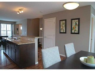Photo 5: 418 WALDEN Drive SE in Calgary: Walden House for sale : MLS®# C3649474