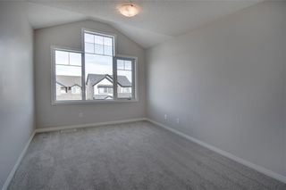 Photo 28: 169 WINDSTONE Avenue SW: Airdrie Row/Townhouse for sale : MLS®# A1064372