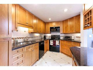 """Photo 10: 844 W 7TH AVE - LISTED BY SUTTON CENTRE REALTY in Vancouver: Fairview VW Townhouse for sale in """"WILLOW CASTLE"""" (Vancouver West)  : MLS®# V1106691"""