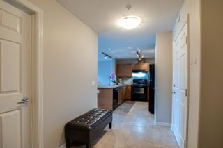 Photo 4: 3310 92 Crystal Shores Road: Okotoks Apartment for sale : MLS®# A1066113