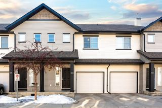 Photo 1: 103 Everridge Gardens SW in Calgary: Evergreen Row/Townhouse for sale : MLS®# A1061680