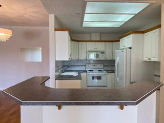 Photo 3: 107 200 Patina Court SW in Calgary: Patterson Apartment for sale : MLS®# A1093695