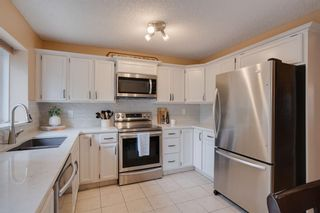 Photo 8: 12 Sunvale Mews SE in Calgary: Sundance Detached for sale : MLS®# A1119027