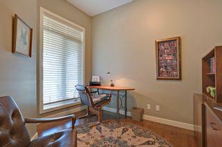 Photo 3: 215 Sunset Square in Cochrane: Duplex for sale : MLS®# C4007845