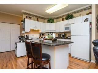 """Photo 6: 106 33502 GEORGE FERGUSON Way in Abbotsford: Central Abbotsford Condo for sale in """"Carina Court"""" : MLS®# R2262879"""
