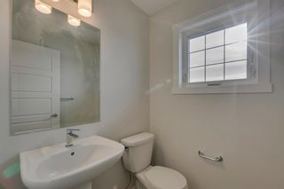 Photo 21: 226 Cranbrook Square in Calgary: Cranston Row/Townhouse for sale : MLS®# A1093078