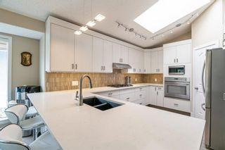 Photo 6: 148 Douglasview Rise SE in Calgary: Douglasdale/Glen Detached for sale : MLS®# A1113437