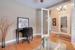 Photo 5: 34 Cougar Ridge Landing SW in Calgary: Cougar Ridge Row/Townhouse for sale : MLS®# A1075174