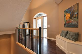 Photo 2: 131 Cougar Plateau Circle SW in Calgary: 2 Storey for sale : MLS®# C3614218