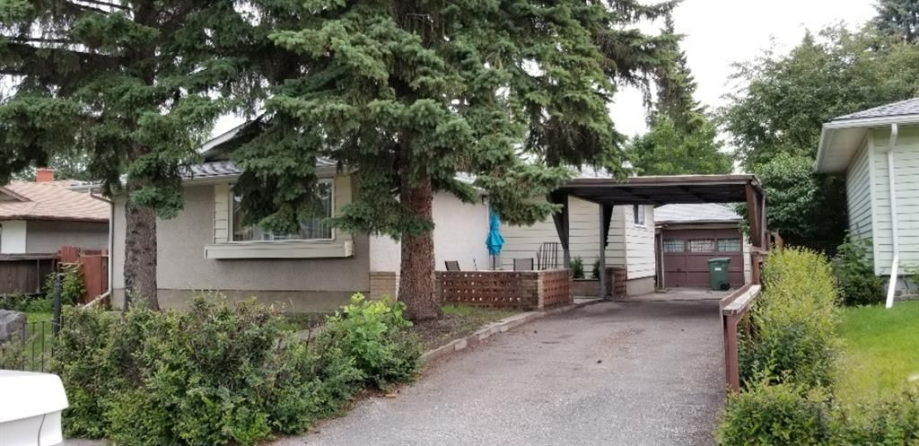 Main Photo: 7402 FAIRMOUNT Drive SE in Calgary: Fairview Detached for sale : MLS®# A1009117