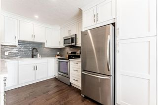 Photo 2: 1441 Ranchlands Road NW in Calgary: Ranchlands Row/Townhouse for sale : MLS®# A1061548