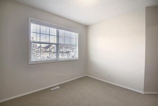 Photo 22: 25 Tuscany Springs Gardens NW in Calgary: Tuscany Row/Townhouse for sale : MLS®# A1053153