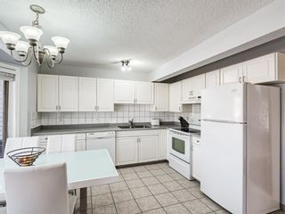 Photo 7: 45 Patina Park SW in Calgary: Patterson Row/Townhouse for sale : MLS®# A1101453