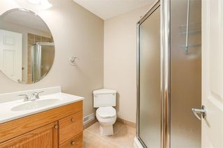 Photo 32: 230 SOMME Avenue SW in Calgary: Garrison Woods Row/Townhouse for sale : MLS®# C4261116