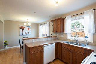 Photo 10: 16 SOMME Way SW in Calgary: Garrison Woods Semi Detached for sale : MLS®# C4232811