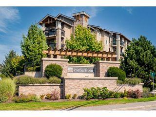 "Photo 1: 412 21009 56 Avenue in Langley: Langley City Condo for sale in ""CORNERSTONE"" : MLS®# R2622421"