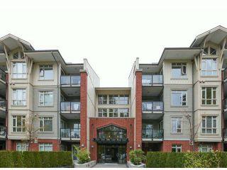 Photo 1: 104 100 CAPILANO Road in Port Moody: Port Moody Centre Condo for sale : MLS®# V1101530