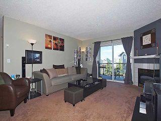 Photo 3: 405 33 ARBOUR GROVE Close NW in CALGARY: Arbour Lake Condo for sale (Calgary)  : MLS®# C3575244