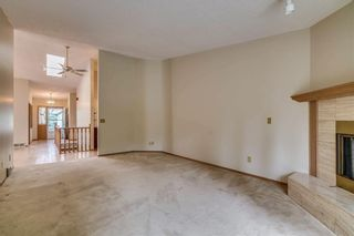 Photo 3: 52 WOODMEADOW Close SW in Calgary: Woodlands Semi Detached for sale : MLS®# C4259772