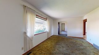 Photo 4: 3712 Bow Anne Road NW in Calgary: Bowness Detached for sale : MLS®# A1140913