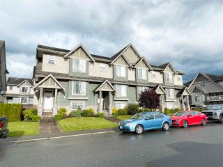 """Photo 1: 3 6498 SOUTHDOWNE Place in Chilliwack: Sardis East Vedder Rd Townhouse for sale in """"Village Green"""" (Sardis)  : MLS®# R2588764"""