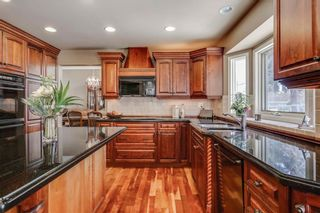 Photo 14: 74 SHAWNEE CR SW in Calgary: Shawnee Slopes House for sale : MLS®# C4226514
