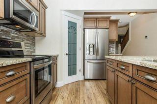 Photo 6: 67 CRYSTALRIDGE Close: Okotoks House for sale : MLS®# C4139446