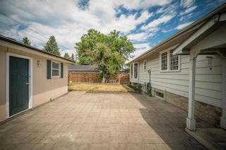 Photo 3: 12023 Candiac Road SW in Calgary: Canyon Meadows Detached for sale : MLS®# A1128675