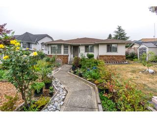 Photo 1: 17989 64 Avenue in Surrey: Cloverdale BC House for sale (Cloverdale)  : MLS®# R2201816